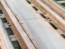 Closeup of railway train track on wooden bridge stock photos