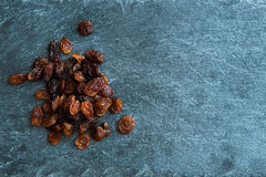 Closeup on raisins on stone substrate Stock Images