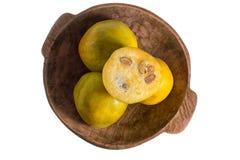 Araza fruit in wood bowl Royalty Free Stock Photo