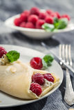 Closeup of raspberry pancakes with almonds and mint leaf Stock Images