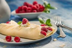 Closeup of raspberry pancakes served with whipped cream Royalty Free Stock Images