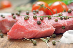 Closeup raw beef steak with green pepper Stock Photo