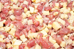 Closeup of raw diced meat and potatoes Royalty Free Stock Photos