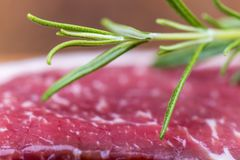 Closeup of raw steak. Closeup of a raw steak with rosemary Stock Photography