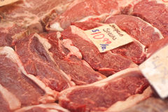 Closeup of raw striploin steaks at Stock Photos