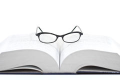 Closeup of reading glasses on the book Royalty Free Stock Images