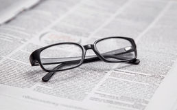Glasses. Closeup of reading glasses on the newspaper Royalty Free Stock Image