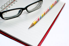 Closeup of reading glasses and pen Royalty Free Stock Photos