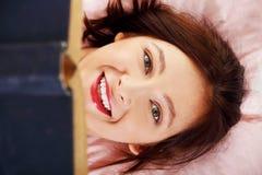 Closeup on reading teen girl`s face. Stock Photos