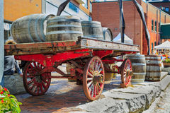 Closeup rear view of vintage classic horse drawn carriage loaded with wooden barrels Stock Photography