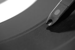 Closeup on record player. A needle playing music on an LP Royalty Free Stock Photo