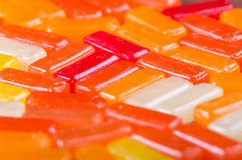 Closeup rectangular colorful shiny hard candy lined up Royalty Free Stock Image