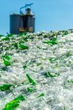 Recycle pieces of broken glass with factory on background royalty free stock images