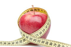 Closeup of a red apple with a measuring tape Stock Image