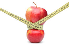 Closeup of a red apple with a measuring tape Stock Images