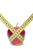 Closeup of a red apple with a measuring tape Stock Photos