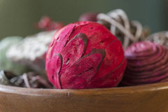 Closeup of red aromatic potpourri ball with natural pieces in wo Stock Photo