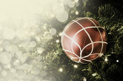 Closeup of red bauble hanging from a decorated Christmas tree. R Stock Photography