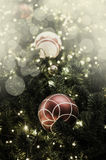 Closeup of red bauble hanging from a decorated Christmas tree. R Royalty Free Stock Photos