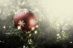 Closeup of red bauble hanging from a decorated Christmas tree. R Stock Photo