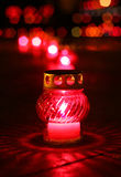 Closeup of red burning votive candle stock images