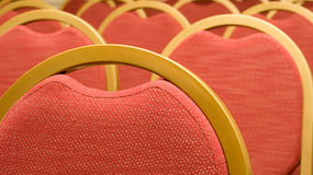 Closeup of red Chair in the conference hall Stock Photos