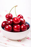 Closeup of red cherries with water drops in white bowl on napkin Stock Photography