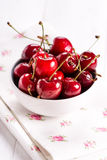 Closeup of red cherries with water drops in white  Stock Photo