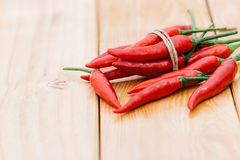 Closeup red chili peppers spice ingredient on wood Stock Photography