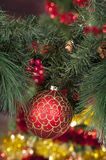 Closeup of red Christmas balls on colored background Royalty Free Stock Images