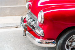 Closeup of red classic vintage car in Old Havana, Cuba. View of red classic vintage car in Old Havana, Cuba Royalty Free Stock Photo