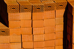 Closeup of red clay bricks stacked in piles Royalty Free Stock Photo