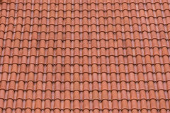 Closeup of the red clay roof tiles. As a background Stock Photo