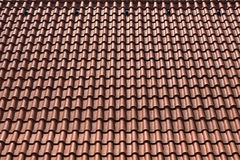 Closeup of the red clay roof tiles Royalty Free Stock Photography
