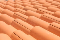Closeup of the red clay roof tiles Royalty Free Stock Photo