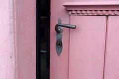 Closeup of red door with old doorhandle Royalty Free Stock Photos