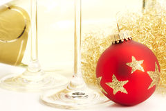 Closeup of a red dull christmas ball with champagn Royalty Free Stock Photography