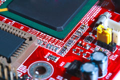 Closeup of red electronic motherboard circuit with processor Royalty Free Stock Photo