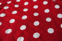 Closeup of red fabric with polka dot pattern. Close view of red fabric with polka dot pattern stock images