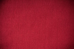 Closeup of red fabric textile material as texture or background. Closeup macro of red fabric textile material as texture pattern background or backdrop Royalty Free Stock Image