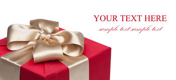 Closeup of red gift box with golden ribbon Stock Photos