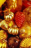 Closeup of red and golden ornaments Stock Photos