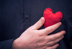 Closeup red heart hand man Royalty Free Stock Photos