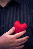 Closeup red heart hand man Stock Photo