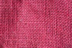 Red hessian texture. Closeup of red hessian texture royalty free stock images