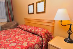 Closeup of red hotel bed Royalty Free Stock Images