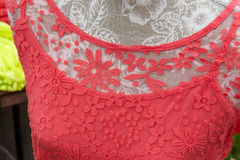 Closeup of a red lace blouse shirt Stock Photography