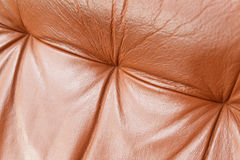 Closeup of red leather recliner chair backrest Stock Photos