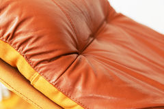 Closeup of red leather recliner chair. A closeup of a red leather recliner chair backrest Stock Images