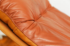 Closeup of red leather recliner chair. A closeup of a red leather recliner chair backrest Royalty Free Stock Photo